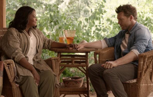 Papa (Octavia Spencer) and Mack Phillips (Sam Worthington) in THE SHACK.